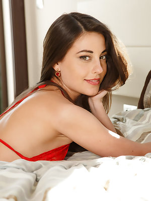 A sexy and seductive Lorena B clad in a skimpy red bikini as she poses and teases on top of the bed