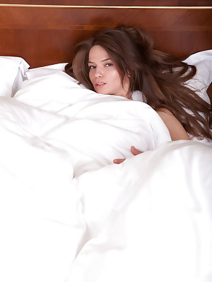 Nedda A looks so sweet and innocent cuddled up under her white down comforter...well, that is until she pulls down the covers.  It's time for toys and some intense pussy teasing.  Watch as this lovely little sex kitten probes her meaty labia and then