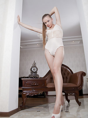 Milena D looks quite sophisticated posing on her leather chair.  Wearing a stunning cream lace bodysuit, with  matching cream colored platform stilettos, she is sure to ensnare you with her long, sexy legs and svelte body.  Her ass is perfect and her puss