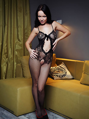 Marica shows off her petite yet amazingly sexy body, clad in a fishnet bodysuit with stockings and stiletto shoes, complimenting her lustrious black hair and seductive face.