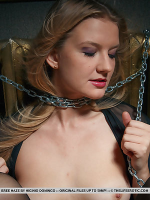 Bree Haze masturbates her yummy pussy while tied in chains.