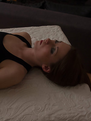 Anna H plays with a rope as she strips her sexy black lingerie and masturbates on   the bed.