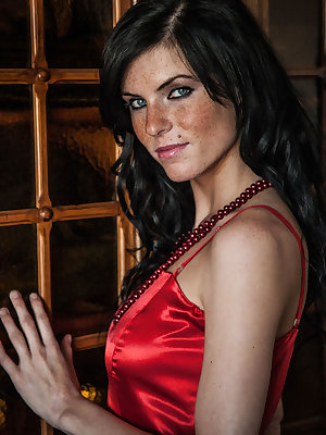 Eileen Sue's silky red lingerie dress and matching red pearl necklace and lace panty amplifies her erotic appeal.