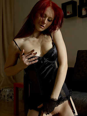 Sultry redhead Sadistra satisfies your dark budoir fantasies with black lace camisole dress, sheer hand gloves, and matching sheer stockings as she strokes and caress her pink assets