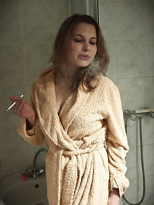 Vlada H smoke a cigarette and self-masturabates in the bathroom.