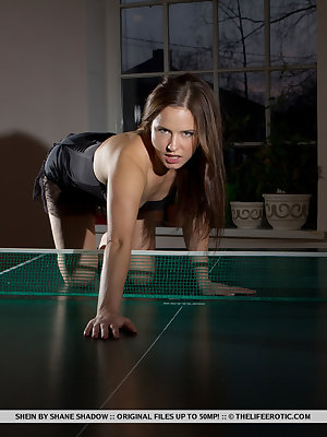 Shein poses and masturbates on top of the table-tennis table.