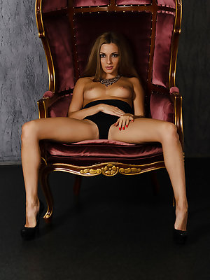 Alyssa A shows off her perfectly tanned body with silky smooth legs and shaven pussy.