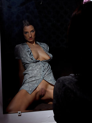 Annija masturbates in front of the mirror as she imagine and fanatasizes having lesbian sex with another woman.