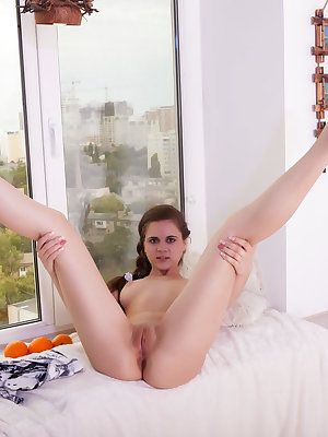 Sexy cutie places herself in comfort and spreads her sexy legs wide to show you some of her great pussy wonders.