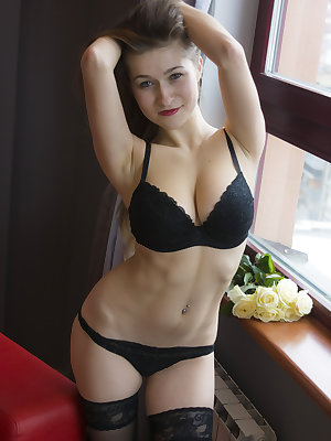 Always smiling, always showing secret look. This slender nude cutie looks amazingly good in that sexy black underwear.