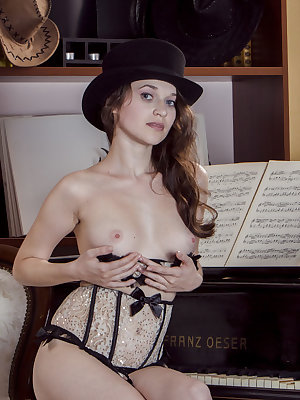 Amazing brunette does not pull rabbits from her hat but sure pulls out a nice piece of pussy from under her panties.