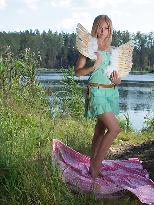 This flawless blonde teen starts flapping her wings on the lap of nature while she is showing off her perfect curves.
