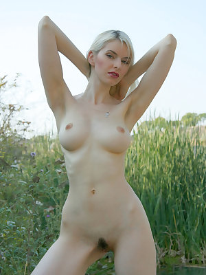 Hot blonde is ready to pose nude on the nature and she knows for real that you will love to see her.