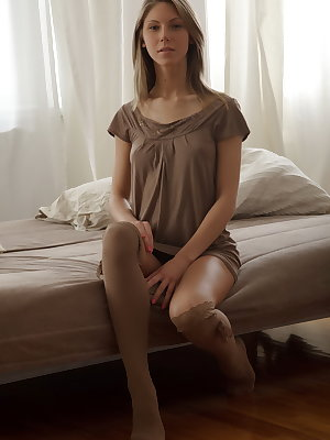 Slender beauty Anjelica wears a wispy dress and stockings she's already rolled down to her knees because she's so excited to expose her lusty flesh and turn you on. Her beautiful body is a dream come true and the erotic video is a tour over her soft and t