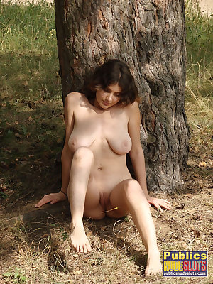 Busty beautiful woman out in nature