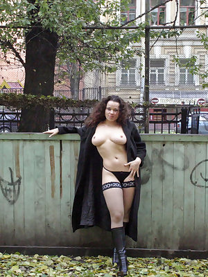 A brunette shares her curves in public