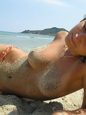 Sweet young girl shows her nice boobs on public beach